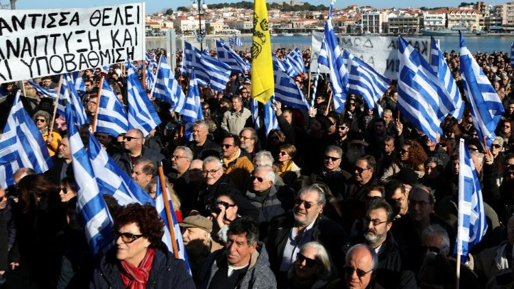 Thousands of Greek protesters demand asylum seekers are removed from their islands, as locals claim: 'You can't walk alone after dark, people get stabbed'