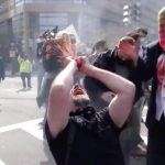 Antifa rioters rip apart fake heart, kneel on burning American flag to protest Trump